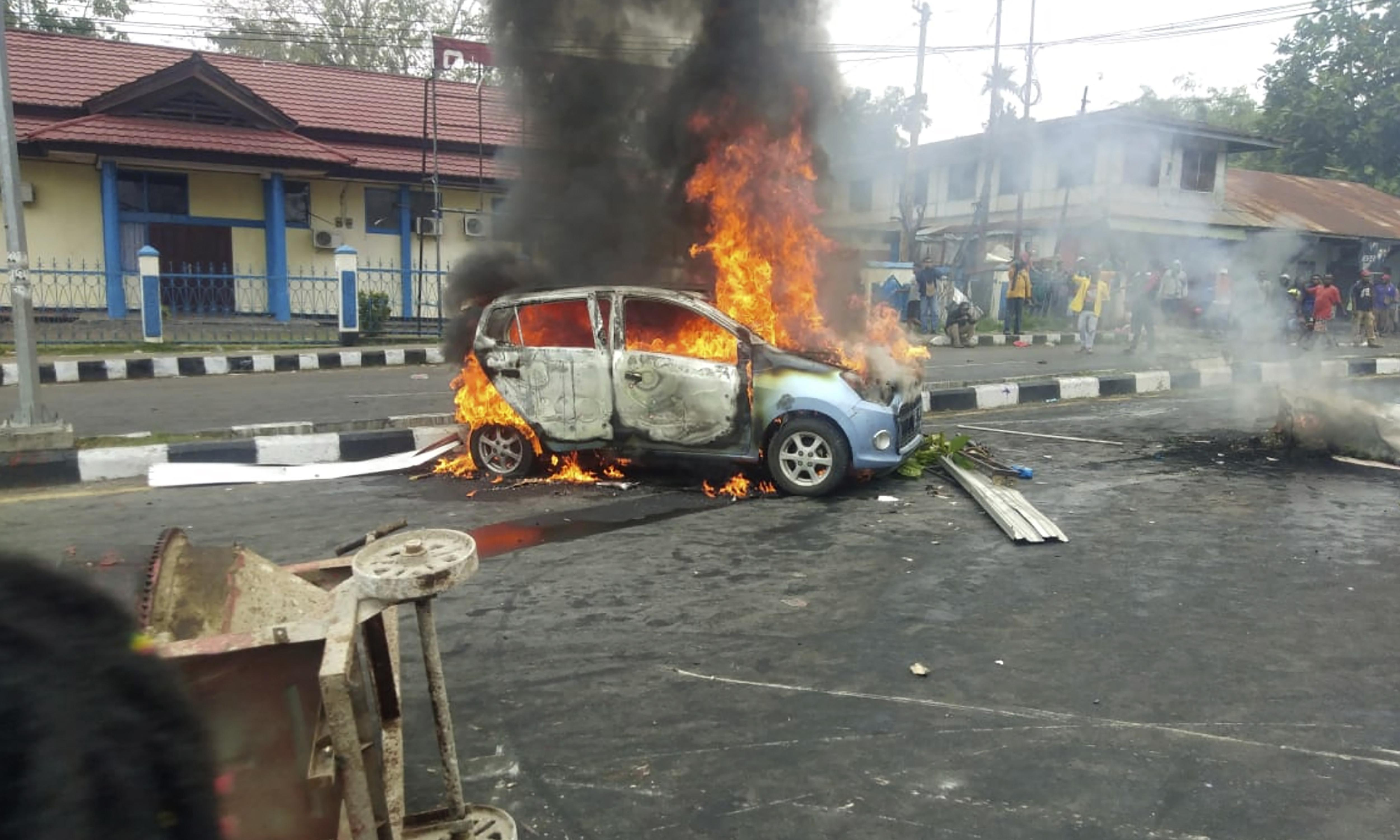 Indonesian president calls for calm after violent protests in West Papua