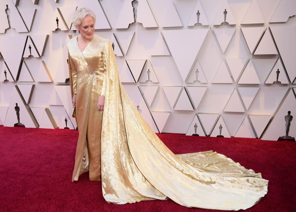 Glenn Close in a gold caped gown