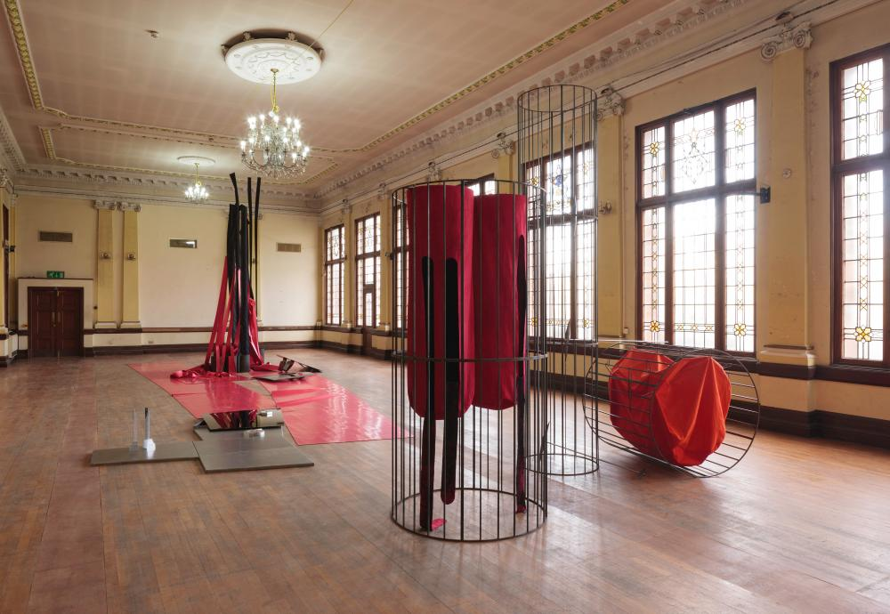 Claire Barclay's installation at Kelvin Hall 'feels both triumphant and tragic'.