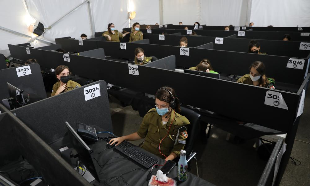 Israeli soldiers in the central national control room headquarters of the Home Front Command dealing with Covid-19 in the city of Ramla near Tel Aviv, 08 October 2020.