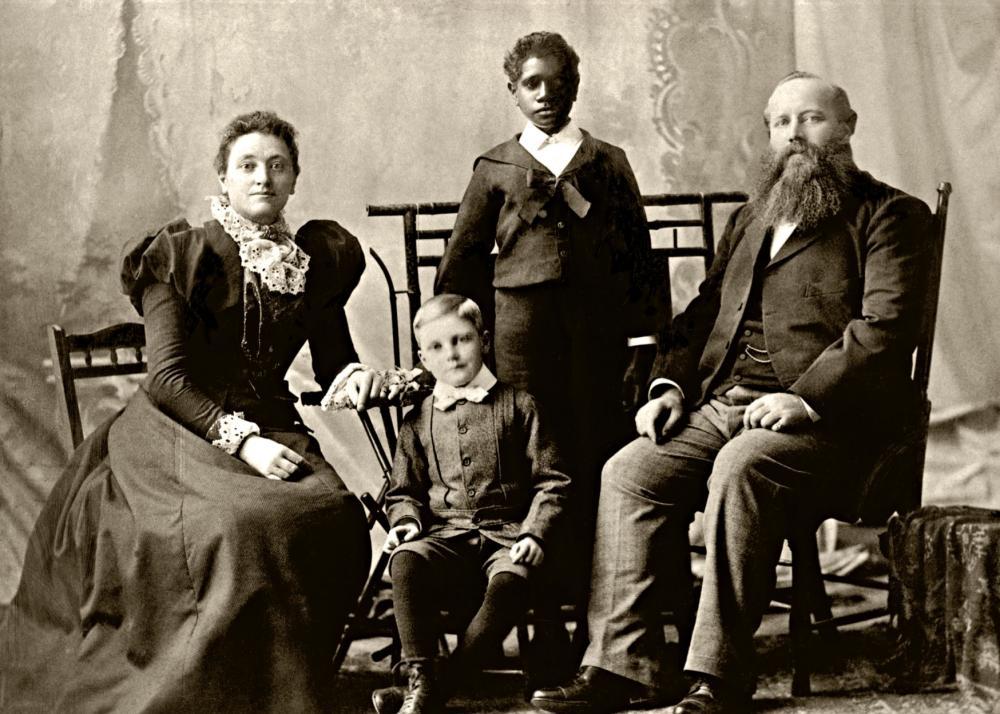 Douglas Grant with foster family Elizabeth, Henry Sneddon and Robert Grant