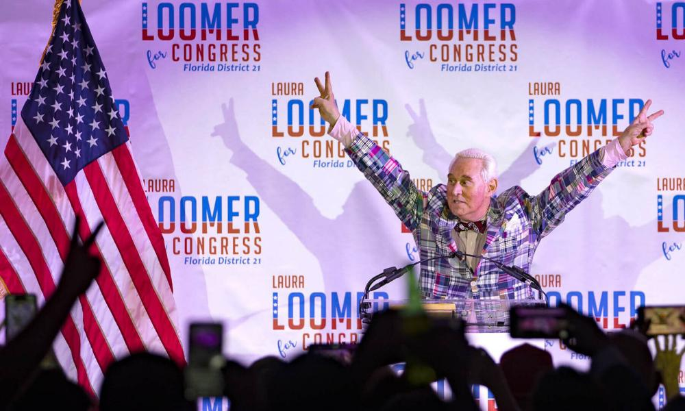 Roger Stone introduces Republican congressional candidate Laura Loomer at an election night event at the airport Hilton in West Palm Beach, Florida, in August. Loomer, a far-right Republican candidate banned from social media sites because of her racist and anti-Muslim speech, is celebrating a congressional primary victory in Florida while embracing her role as a general election underdog in a heavily Democratic district that Donald Trump calls home.