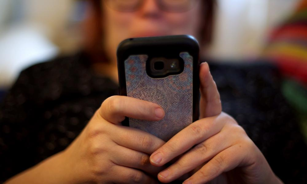 File photo of a woman using her mobile phone