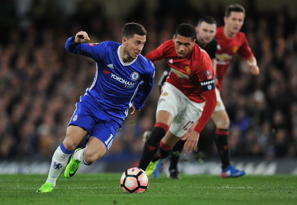 Eden Hazard holds off the challenge from Chris Smalling.