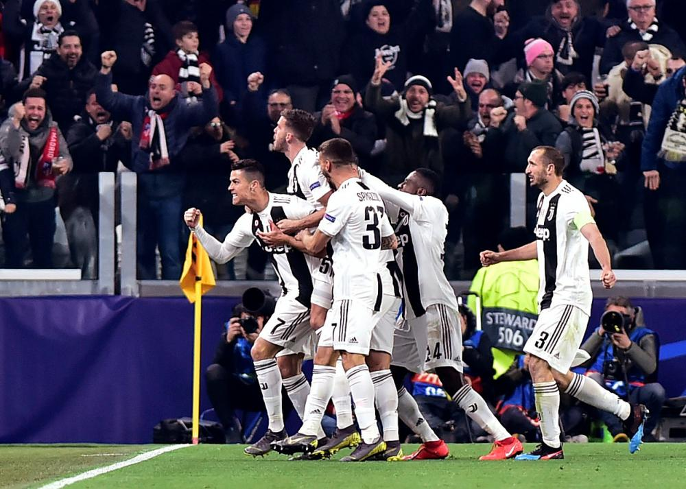Juventus' Cristiano Ronaldo celebrates scoring their second goal with teammates.