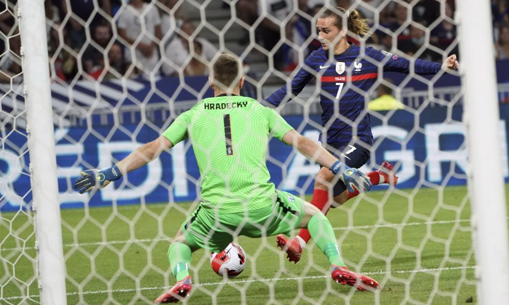 France's Antoine Griezman scores his side's second goal past Finland's goalkeeper Lukas Hradecky.