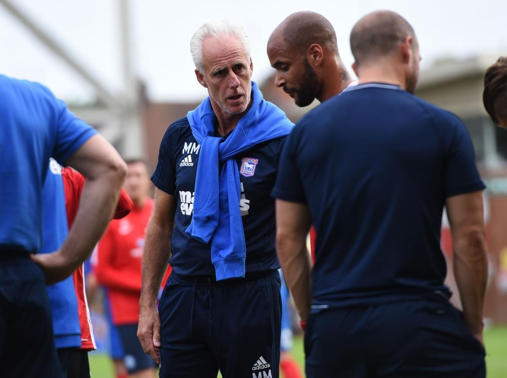 Mick McCarthy talks to David McGoldrick during Ipswich's friendly against Peterborough United.