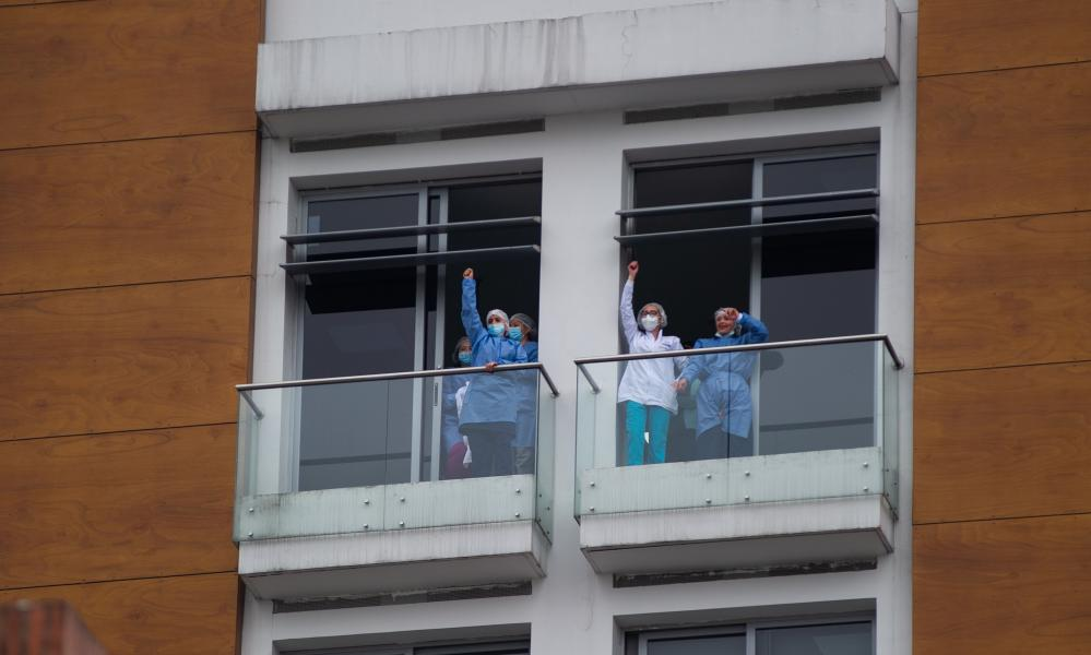 Nurses from a hospital wave during demonstrations in Bogotá, Colombia, on 3 May.