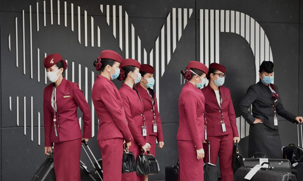 Qatar Airways crew prepare to enter Sydney international airport to fly a repatriation flight back to France on 2 April 2020.