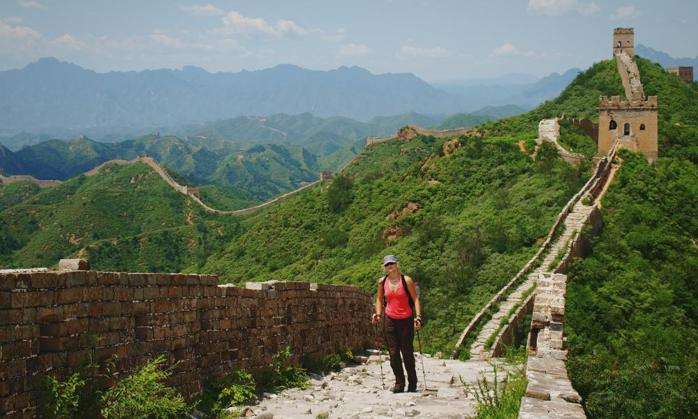 Solo woman trekking on the Great Wall Of China.