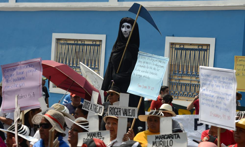 People protest against violence and insecurity and demand justice over the murder of Honduran high-profile indigenous environmental activist, Berta Caceres.