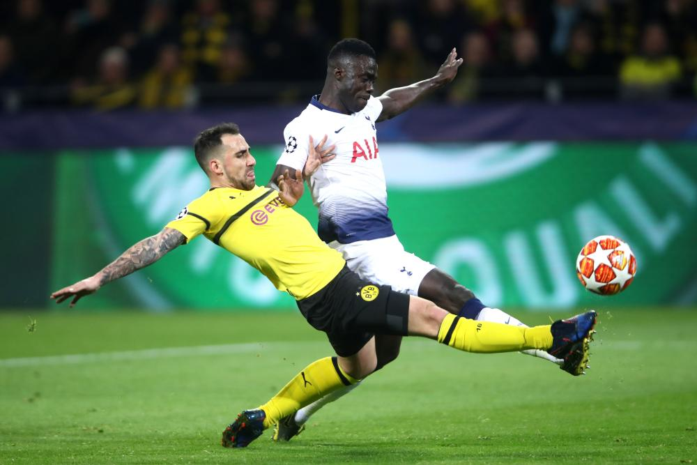 Davidson Sanchez of Tottenham Hotspur is beaten to the ball by Paco Alcacer of Borussia Dortmund.