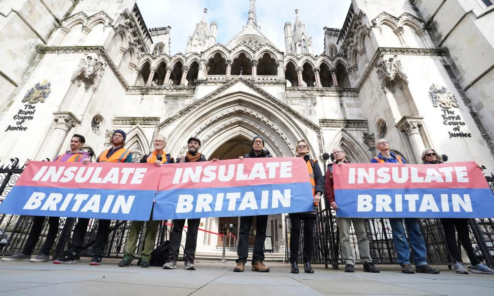 Insulate Britain activists outside the Royal Courts of Justice in London.
