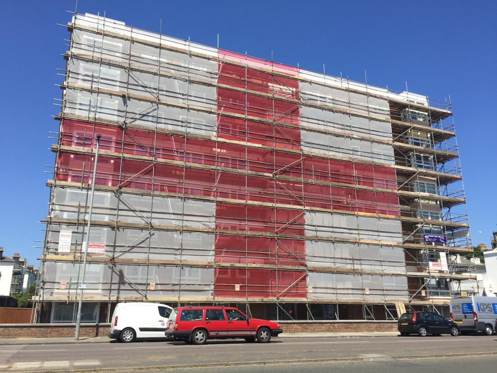 A giant England flag assembled by scaffolders on an eight-storey block of flats in Hove.