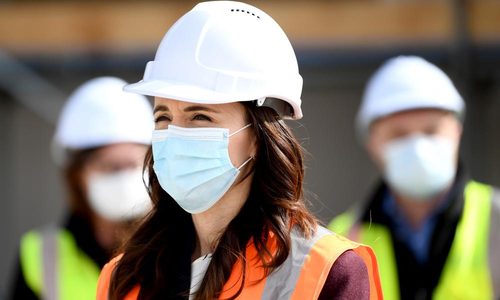 New Zealand Prime Minister Jacinda Ardern wears a mask during a visit to the Kainga Ora housing development in Auckland.