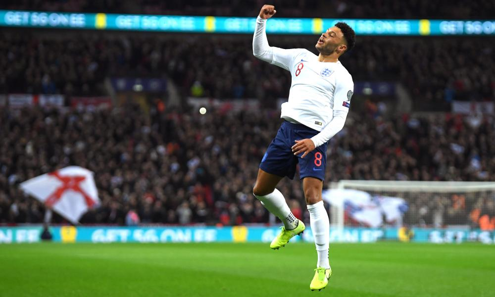 Alex Oxlade-Chamberlain of England celebrates after scoring his sides first goal.