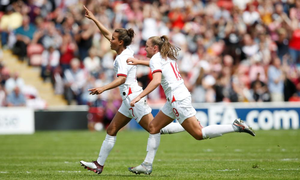 England's Nikita Parris celebrates scoring their first goal