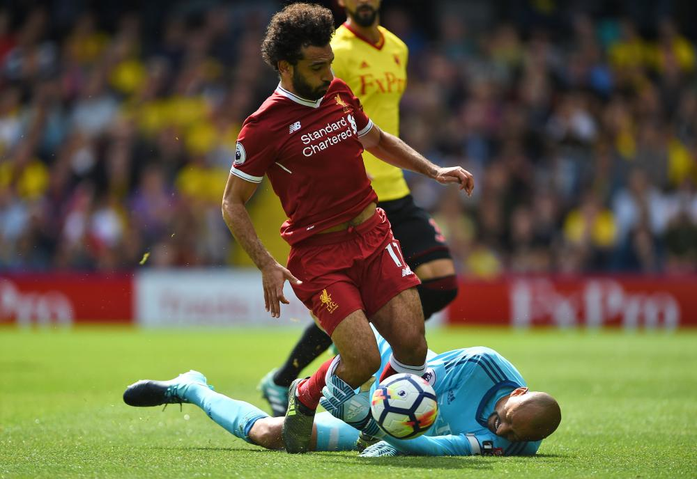 Mohamed Salah is downed by Heurelho Gomes.