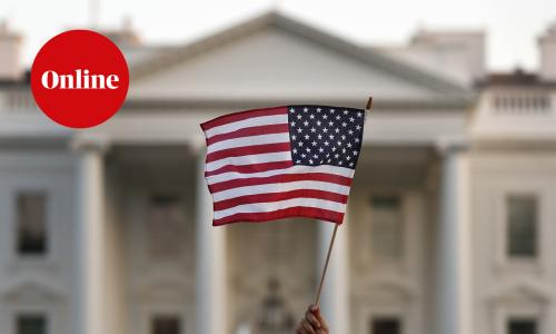 A flag is waved outside the White House, in Washington.