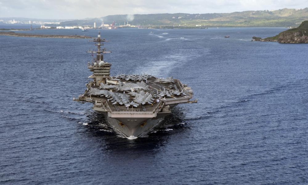 The aircraft carrier USS Theodore Roosevelt departs Apra Harbor in Guam.