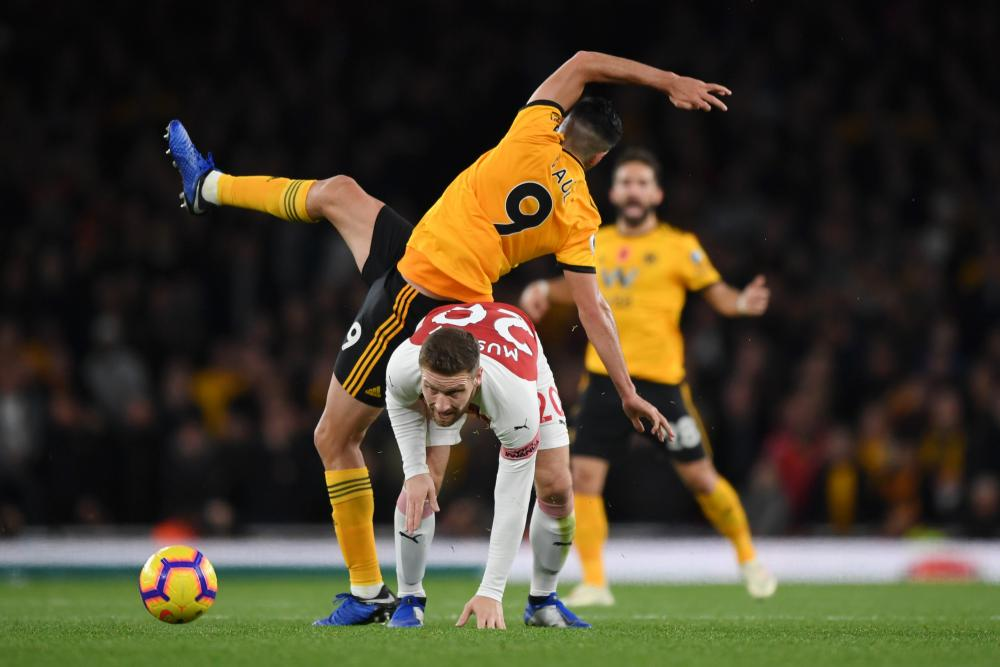 November 11: Shkodran Mustafi of Arsenal battles for possession with Raul Jimenez of Wolverhampton Wanderers.