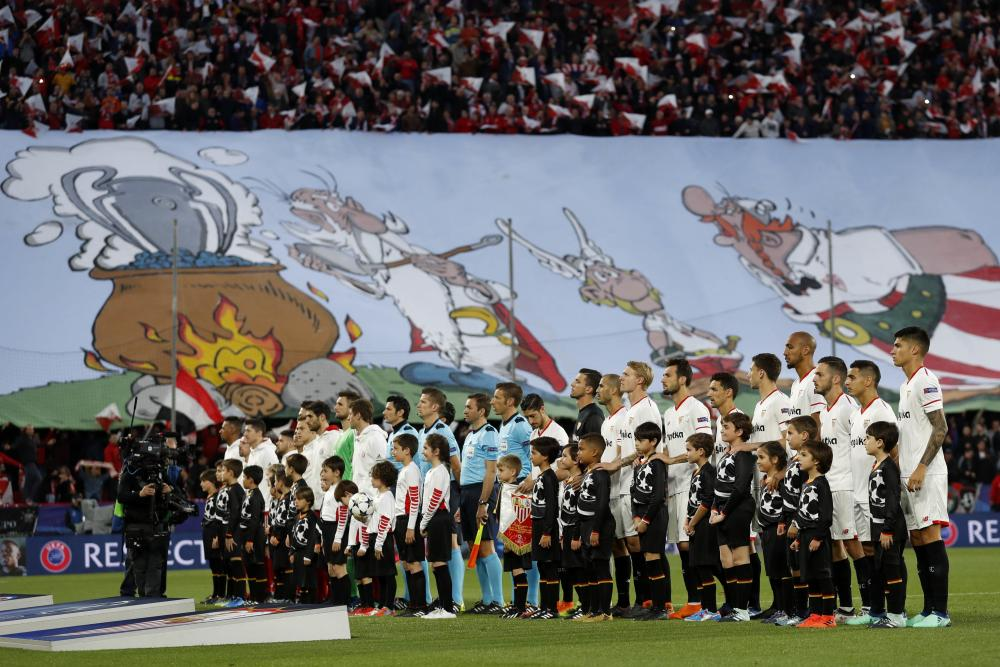 The two teams line up in Seville.