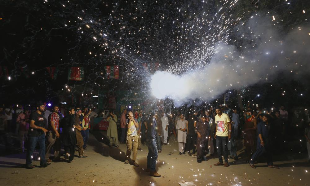 A Khan supporter releases fireworks in the streets in Islamabad.