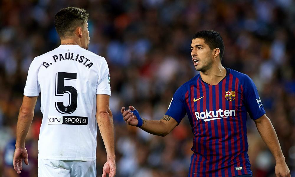 Gabriel Paulista argues with Luis Suárez during a La Liga game. 'Suárez talks to you all the time because he wants to put you off. But at the end, he'll give you a hug'