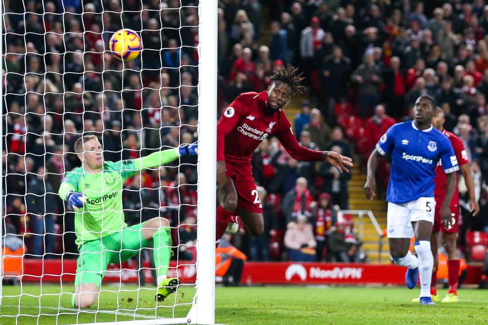 December 2: Divock Origi of Liverpool scores a late goal to defeat Everton.