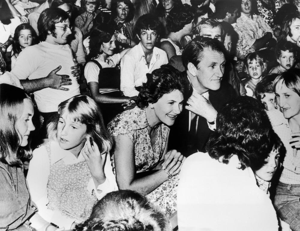 Australian prime minister Malcolm Fraser attends an Abba concert in Melbourne at the Sidney Myer Music Bowl on 18 March 1977. He is with his wife Tamie and daughters Angela and Phoebe.