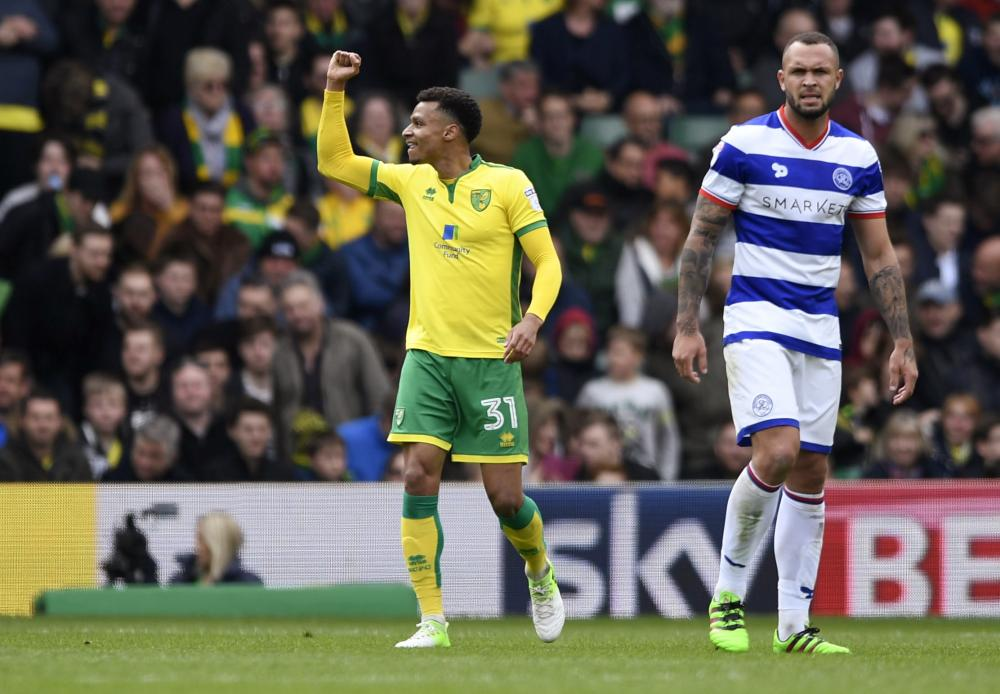 Josh Murphy celebrates scoring the third for Norwich.