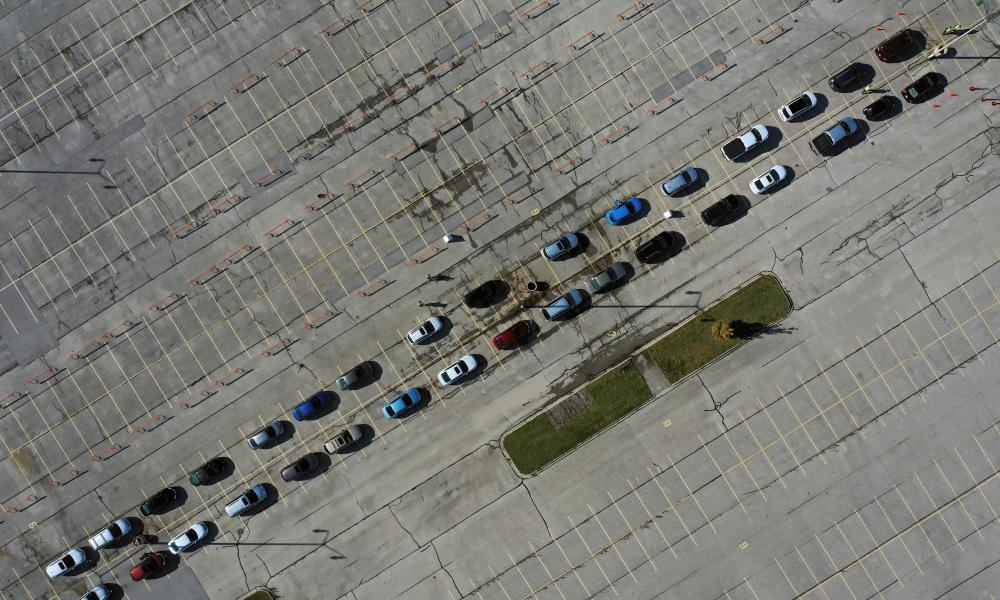 Aerial view of people waiting in their vehicles for Covid-19 tests at a drive-thru testing site in Milwaukee, Wisconsin.