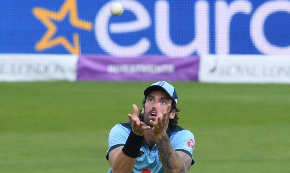 England's Reece Topley takes a catch to dismiss Ireland's Lorcan Tucker.