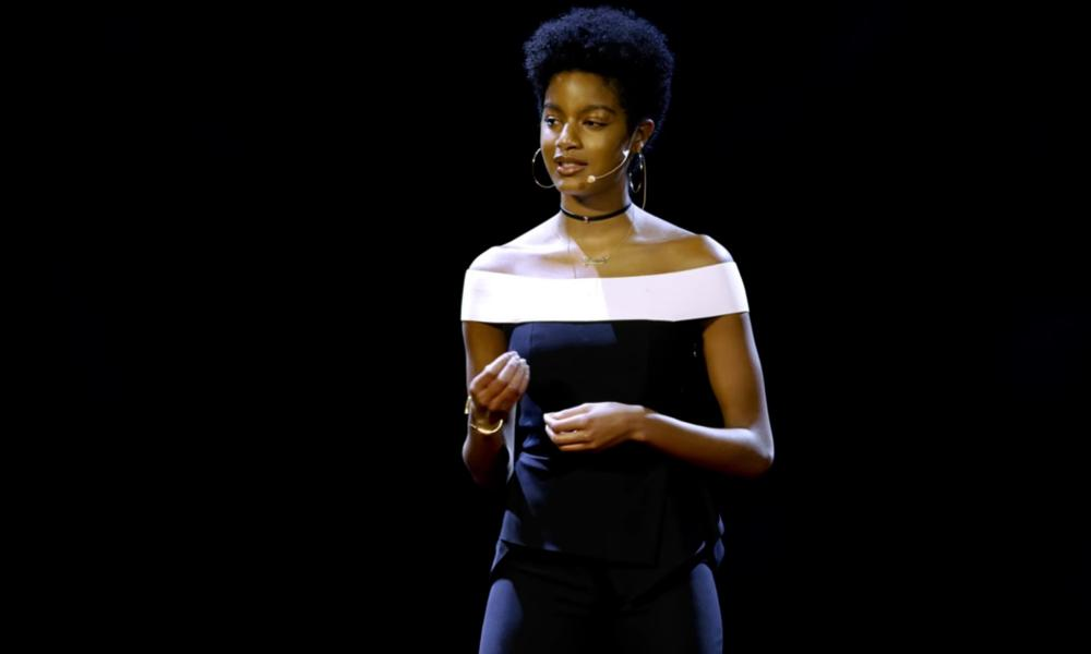 Ebonee Davis giving a TED talk.