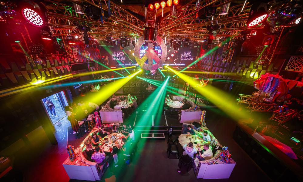 People eat and drink at their table in a nightclub transformed into a restaurant to conform to coronavirus measures in Lausanne, Switzerland.