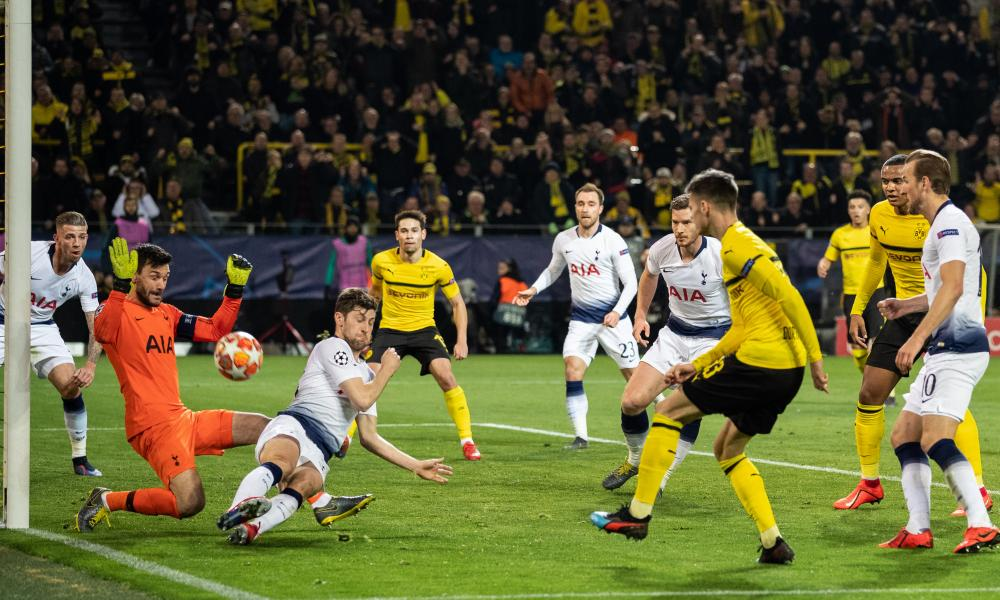 Julian Weigl of Borussia Dortmund is thwarted by Spurs' keeper Hugo Lloris and Ben Davies.