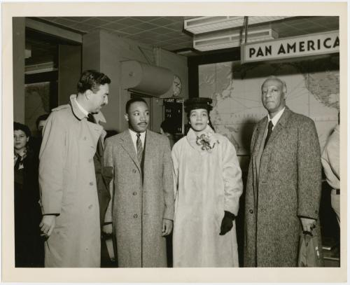 Martin Luther King Jr and his wife Coretta greeted by the Rev Adam Clayton Powell Jr (left) and labor leader A Philip Randolph (right) at the Pan American World Airways terminal, in New York City