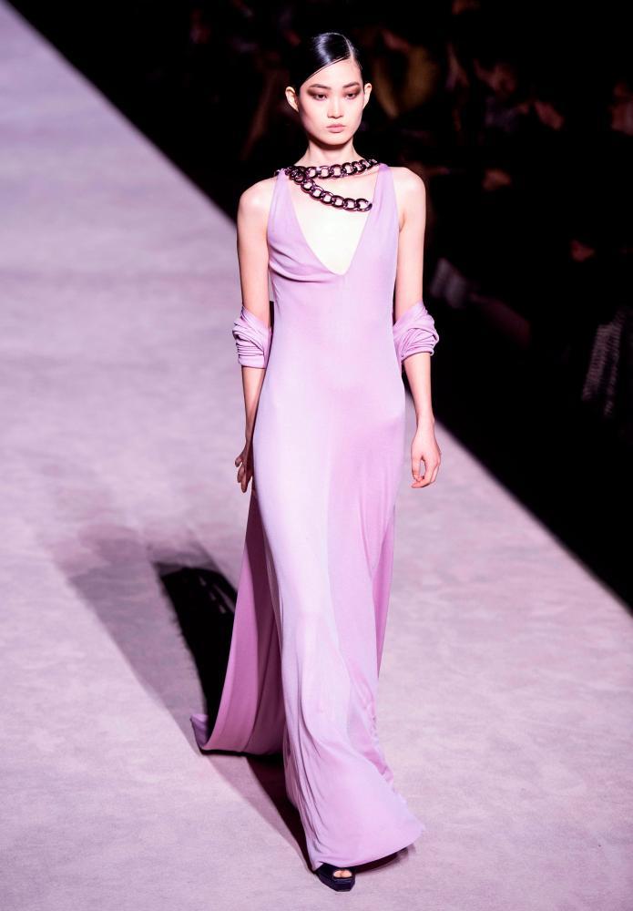 Model in pink dress on catwalk
