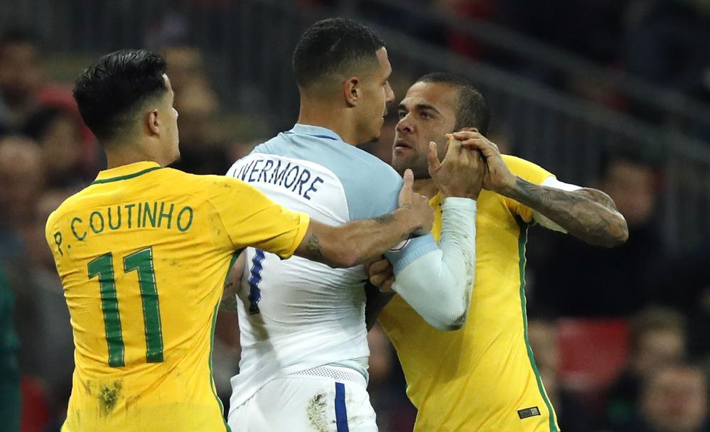 Jake Livermore clashes with Dani Alves.