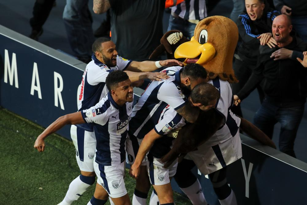 Baggie Bird joins in the celebrations of Craig Dawson's goal.
