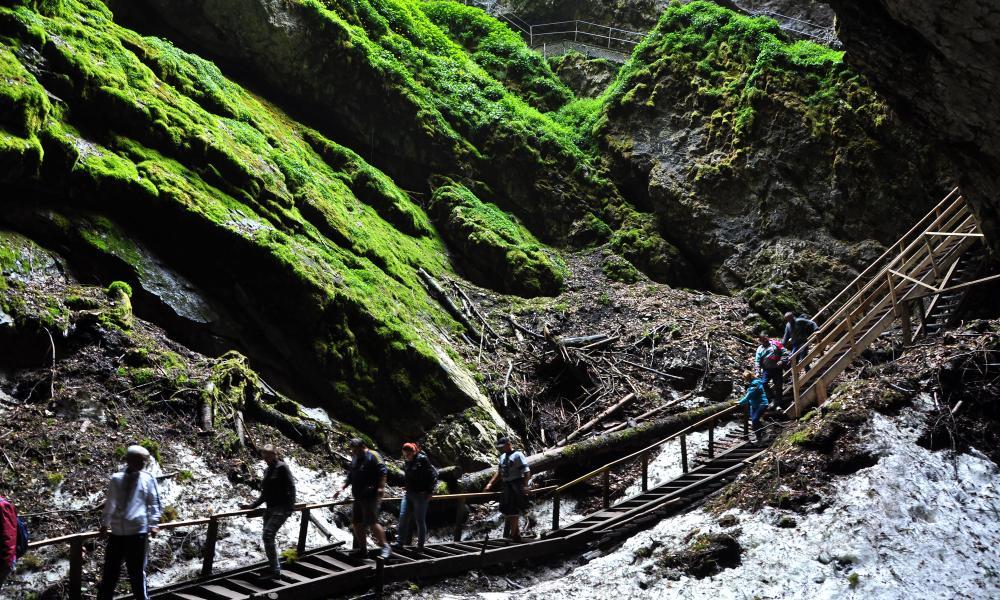 Tourists visiting the Scarisoara ice cave, Romania