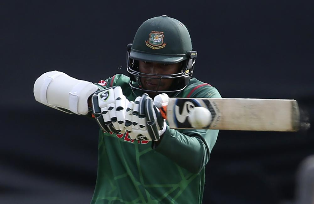 Shakib Al Hasan plays a shot on his way to a half-century.