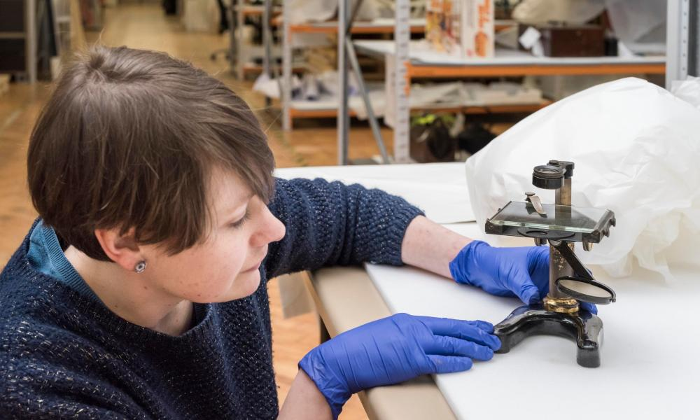 A worker at Blythe House, west London packing a microscope ready for transit to the new site.