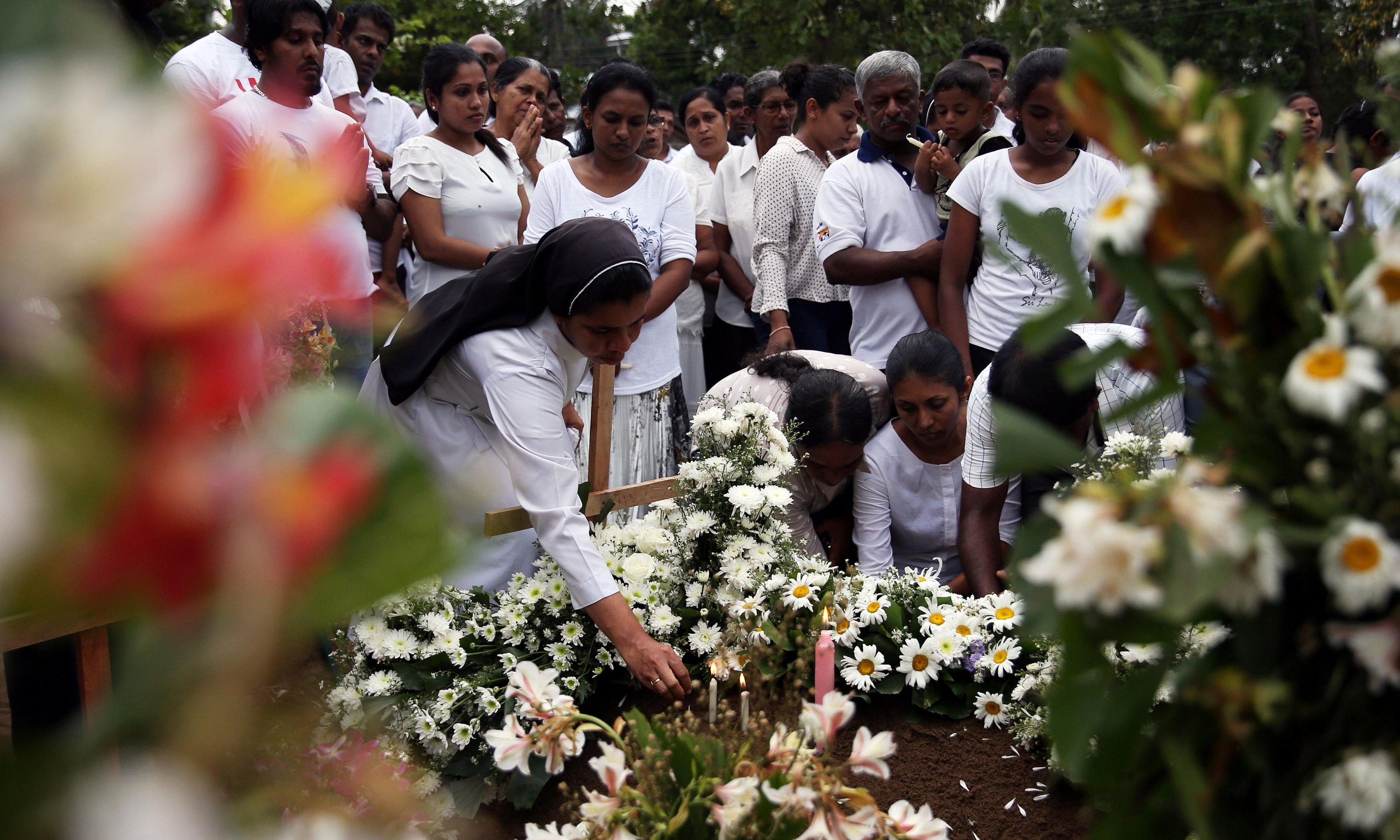 Death toll in Sri Lanka bombings revised down to 253