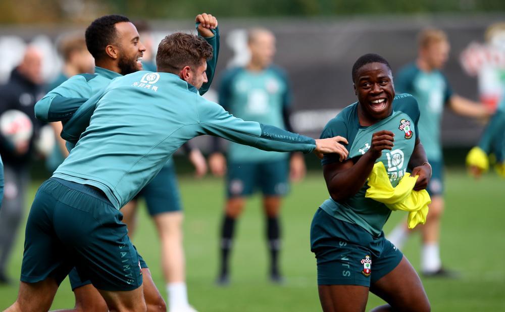 Michael Obafemi jokes with teammates during Southampton training on Thursday.