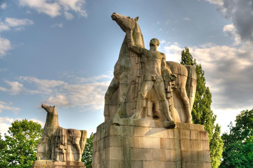 Statue of the Rossebändiger in North Parc of Düsseldorf, Germany. Sculptor Edwin Scharff, 1937-1940.