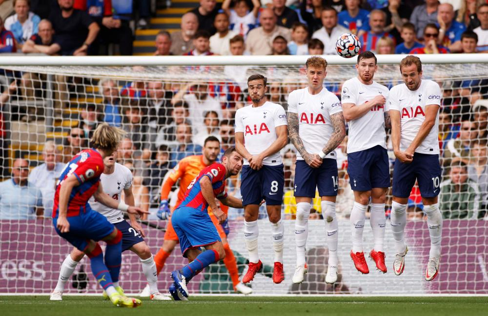Crystal Palace's Conor Gallagher shoots at goal from a free-kick.