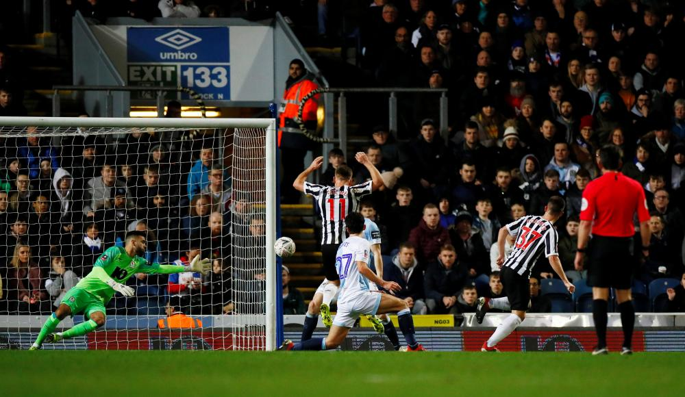 Newcastle United's Callum Roberts volleys in the second.