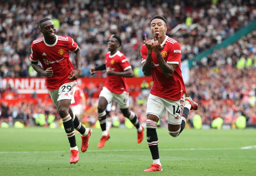 Jesse Lingard of Manchester United celebrates after scoring his side's fourth goal.