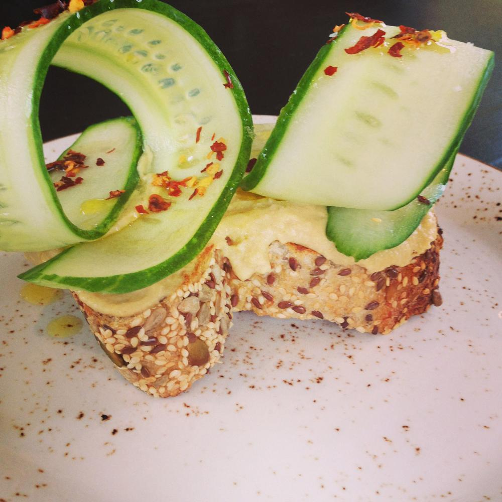 Toast with hummus, chilli and cucumber at Crompton Coffee in Richmond, Melbourne. The cafe serves dishes compromising of ... toast.